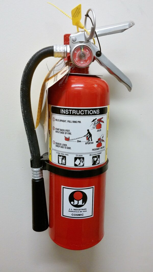 fire extinguisher mounted to wall