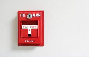 fire alarm systems pull down alarm on wall
